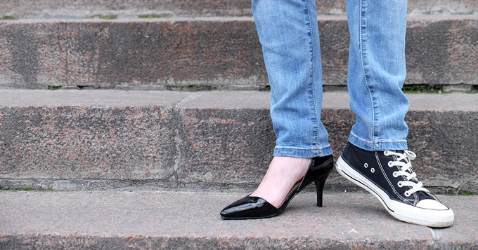 Photo of a Woman Wearing Two Different Shoes