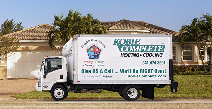 Sarasota Air Conditioning Company - Kobie Complete service vehicle parked in front of house